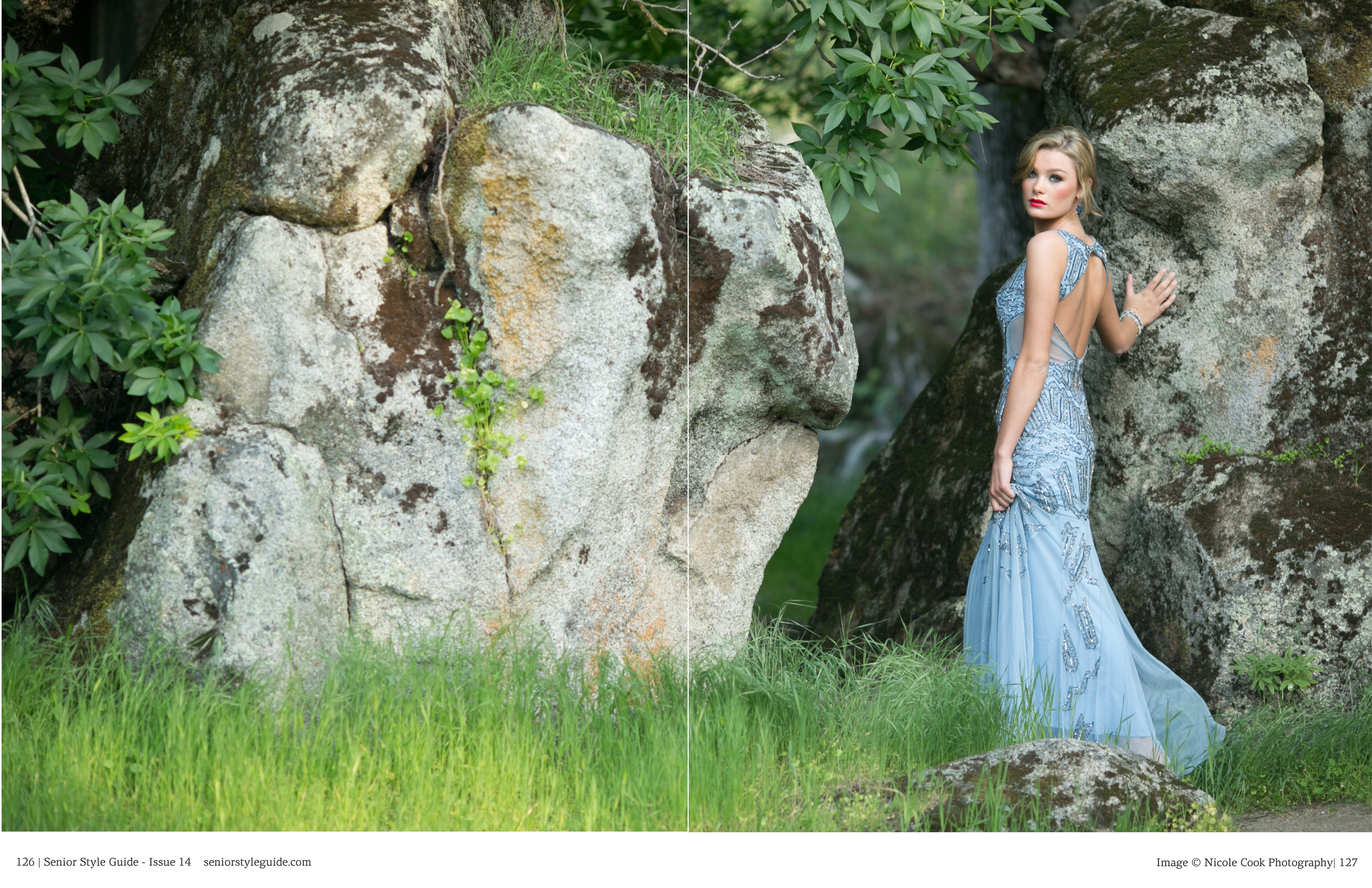high school senior in green grass and rock formations