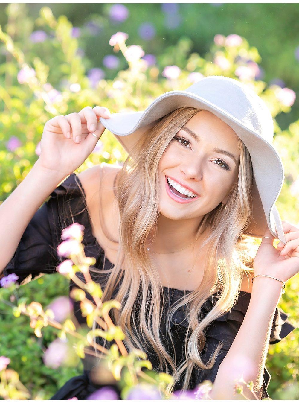 blonde senior high school girl in hat