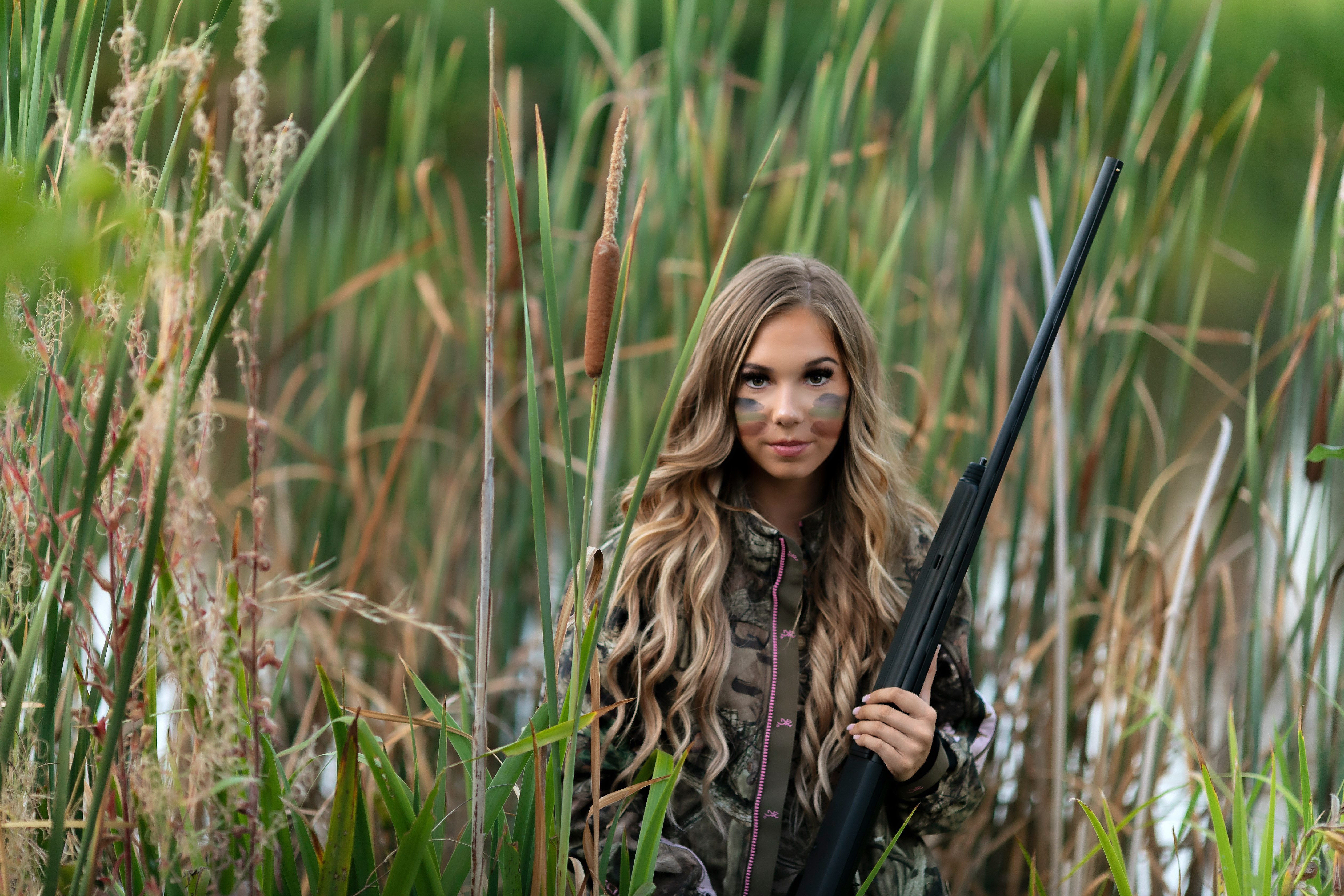 Teen girl in duck hunting gear and camo with gun