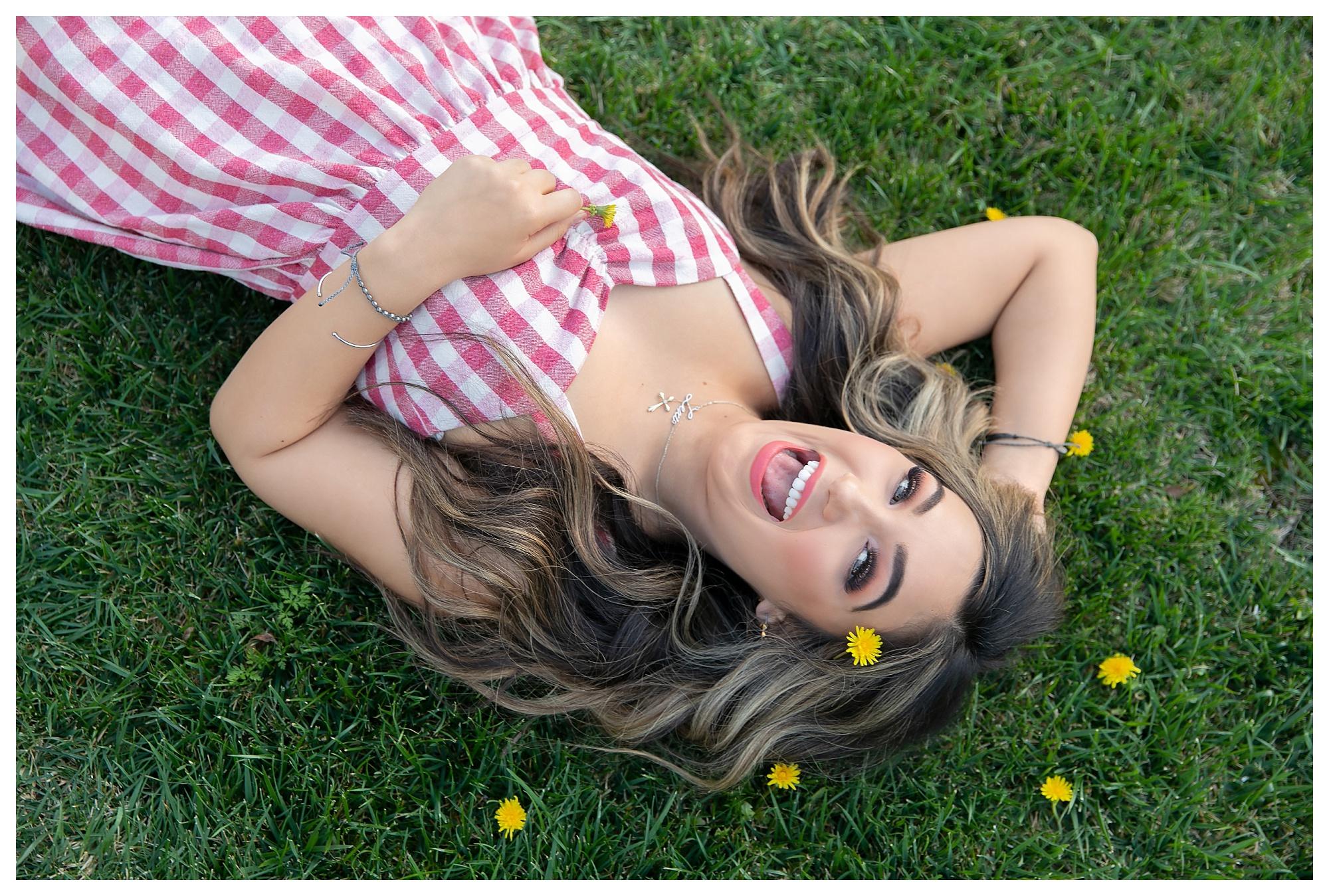 Teen girl in dandelion flowers