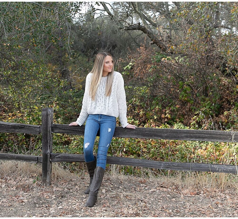 blonde teen be wooden fence
